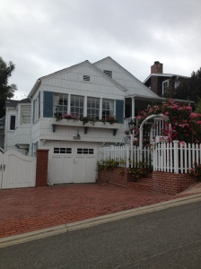 "Loving the pink flowers with the blue and white house. Shabby chic at its finest! Can we call houses in Laguna ""shabby chic?"""
