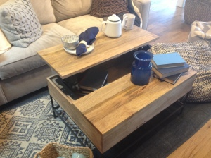 I just love that this coffee table provides storage and lifts for an easy way to eat or enjoy tea in front of the tv.