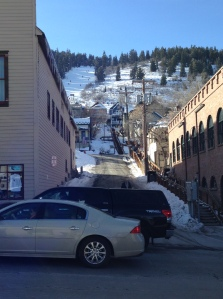 Looking through an alley in downtown Park City. You can see people skiing down to the town area at the top left. There were a few places you could ski down to for lunch.