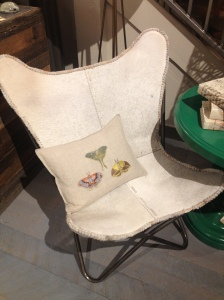 Who doesn't love a butterfly  chair? The animal hide seat stays true to Park City Style.