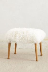 I'm obsessed with these furry stools from Anthropologie. They ring in at $348 each (eeps!) But you could get a similar look by throwing a sheep skin over a small stool.