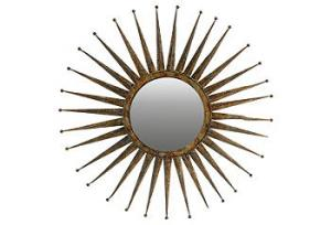 I'd put this fun mirror on the opposite wall from the side table with the lamp to reflect light.