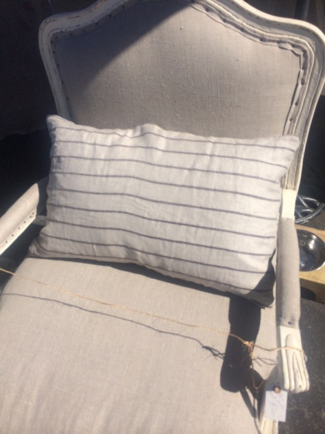 This type of chair isn't normally my style, but the fabric on this collection was so pretty, I considered buying one.   I settled on ordering one of these pretty striped linen pillows, which is much more in line with my style (and the style of my home.)