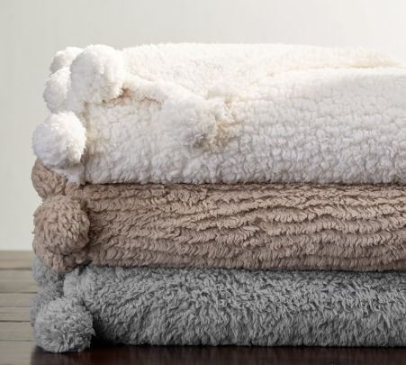 pottery barn cozy pom pom throw